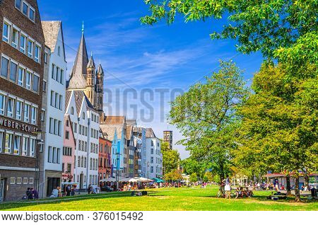 Cologne, Germany, August 23, 2019: Typical German Houses And Buildings And Green Grass Lawn With Tre