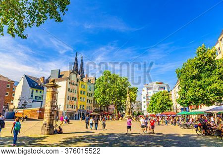 Cologne, Germany, August 23, 2019: Colorful Buildings, Jan-von-werth-denkmal Monument And People Tou