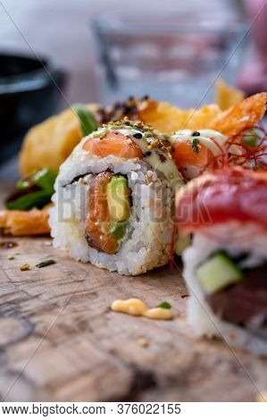 Japanese Food, Fresh Sushi Or Sashimi Made From Rice With Salmon, Avocado, Cucumber, Red Fish Caviar