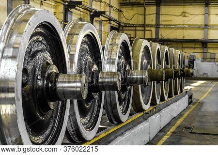 Steel Wagon Wheels In A Repair Depot. Wheels Of Train In Service.