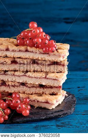 Stack Of Shortbread Cookie With Red Currant Jam.