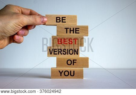 Concept Of Building Success Foundation. Men Hand Put Wooden Blocks On The Stack Of Wooden Blocks. Te