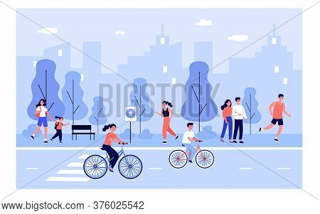 People On City Street. Happy Young Men And Woman Walking Outdoors, Riding Bikes Down Urban Road, Spe