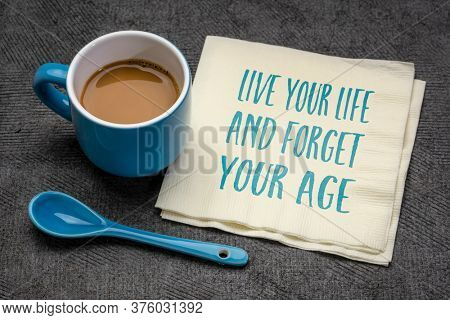 Live your life and forget your age inspirational note - handwriting on a napkin with a cup of coffee, aging and personal development concept