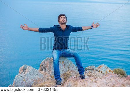 Man Smiling Looking Up To Blue Sky Taking Deep Breath Celebrating Freedom Sea Background At Sunset.