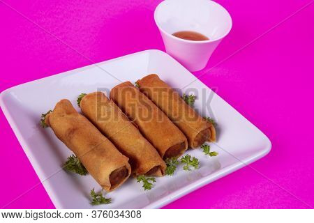 Four Spring Roll Appetizers With Duck Sauce