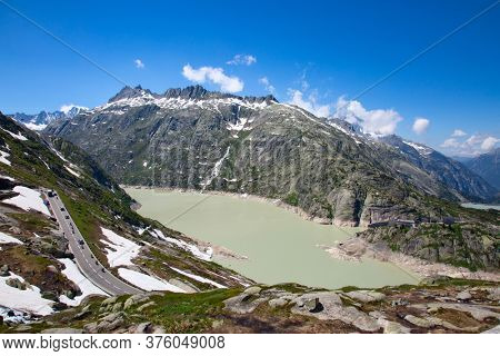 Rhone glacier, source of Rhone river, melting and retreating due to global warming. Rhone glacier is loosing up to 2 meters in length every year.