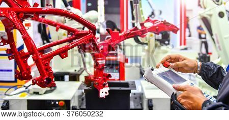 Engineer Check And Control Automation Robot Arm Machine For Automotive Structure Of Motorcycle Proce