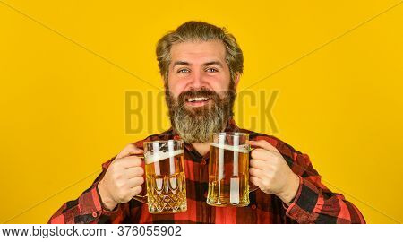 St Patricks Day Concept. Having Fun Watching Football. Brutal Bearded Male Drinks Beer From Glass. B