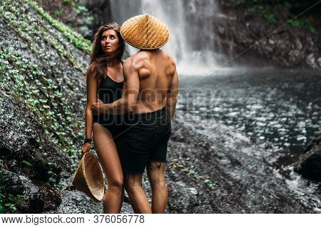 A Couple In Love On Vacation In Asia. The Couple Is Vacationing In The Tropics. Beautiful Couple At