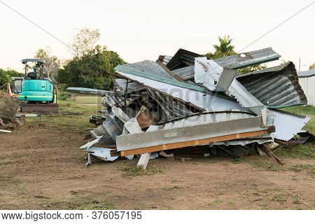 Corrugated Iron Roof Sheeting In Pile On Building Site With Machinery