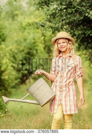 Watering Tools. Girl Child Hold Watering Can. Spring Gardening Checklist. Measure Soil Water Content