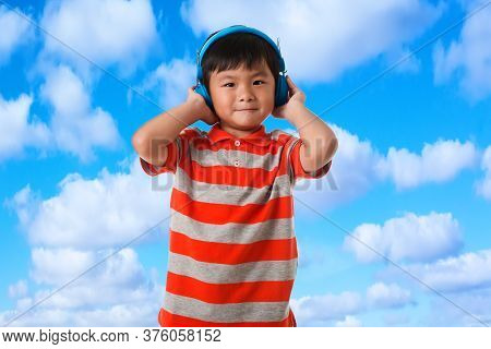 Music And Technology Concept.asian Little Boy With Headphone On White Background