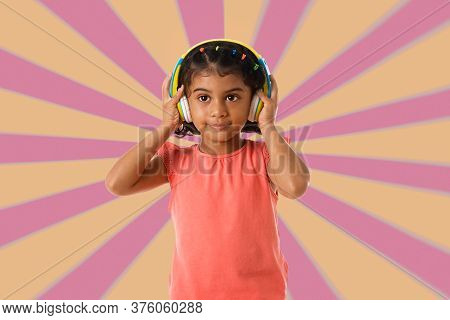 Music, Childhood And Technology Concept.child With Headphones Over Geometric Background