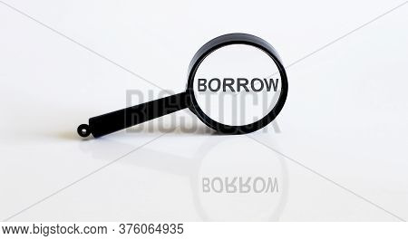 Magnifier With Text Borrow On The White Background