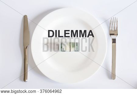 Word Dilemma Of Usa Dollar Currency Concept Photo With Default Sign On White Plate