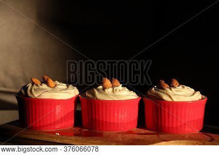 Sweet Dessert. Tasty Cupcakes With Almond In Ramekins