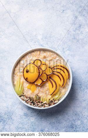 Kids Breakfast Oatmeal Porridge With Fruit Look Like A Golden Fish