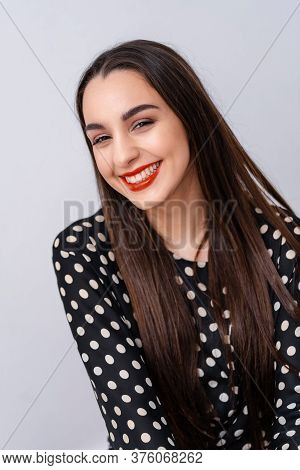 Woman Smiling With Perfect Smile And White Teeth At Camera. White Background.