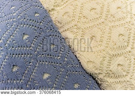Two Pullovers Of Different Colors, Knitted Wool Textures, Winter Background.