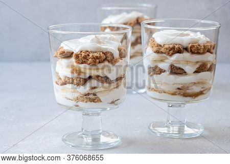 Banana Caramel Parfait Trifle Desserts With Fresh Whipped Cream And Chocolate Cookie Crumbles