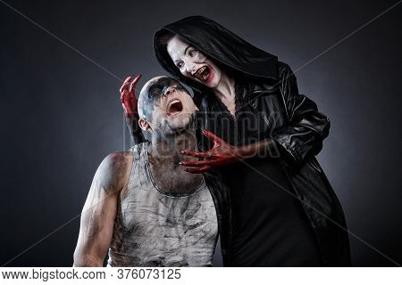Photo Of Bald Mad Man And Horror Woman With Blood Hands