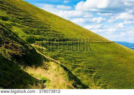 Travers Path Through Mountain Range. Grass On The Hills And Steep Slopes. Summer Landscape On A Sunn