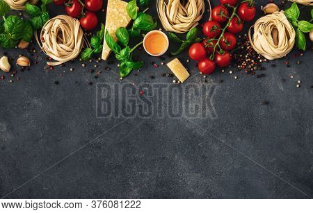 Iettuccine With Ingredients For Cooking Italian Pasta On Dark Background Top View