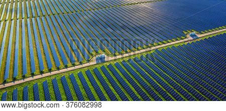 Photovoltaic Power Plant Solar Panels In Aerial View