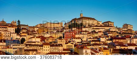 Old Town Of Coimbra Glows At Night Under A Pretty Summer Sky, Portugal In Europe