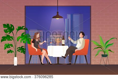 People In Restaurant. Loving Couple Man And Woman Sit At Table Drink Vine Talking, Celebrate Valenti