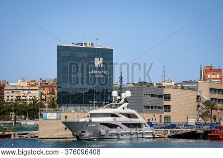 Barcelona, Spain - June 9, 2014: A Luxury Yacht Moored In The Port Of Barcelona Called Port Vell, In