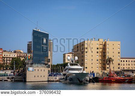 Barcelona, Spain - June 9, 2014: Luxury Yacht And Spanish Coast Guard Patrol In The Port Of Barcelon