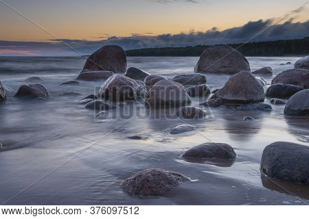 Boulders On The Gulf Of Finland, Baltic Sea. Boulders Surrounded By Water At Long Exposure.