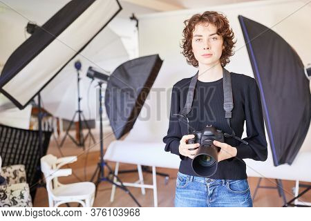 Professional photographer with SLR camera in the photo studio
