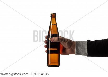 Empty Golden Colored Beer Bottle In Male Hand Isolated On White Studio Background. Concept Of Beer,