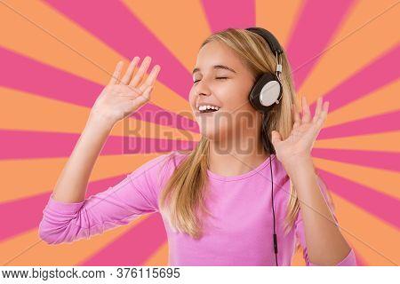 Happy Singing Teenage Girl With Headphones Over Geometric Background