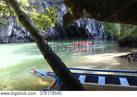 Puerto Princesa, Philippines - November 29, 2017: People Ride The Boats To Underground River In Puer