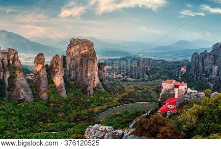 Wonderful View Of The Rocks And Monasteries Of Meteora, Greece. Mysterious Sunny Morning With Blue S