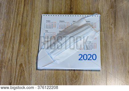 Medical Mask And Calendar, Sanitary Mask And Desktop Chronology