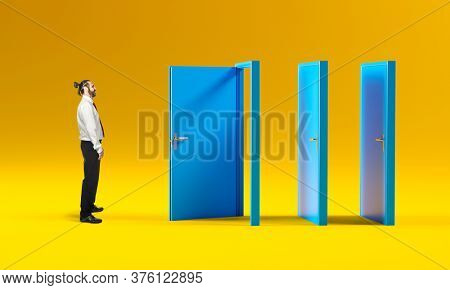 businessman opens a door but finds others closed. concept of adversity, challenge determination.