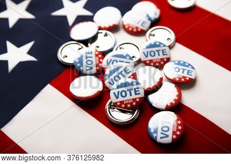 Us Elections Concept Vote Usa. Vote Election Badge Button For 2020 On Flag Of America Background