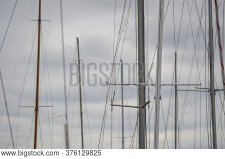 Yacht Masts On A Cloudy Background The Sky