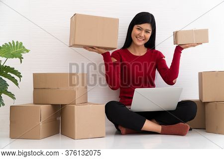 Happy Asian Young Entrepreneur, Smile For Sales Success After Checking Order From Online Shopping St