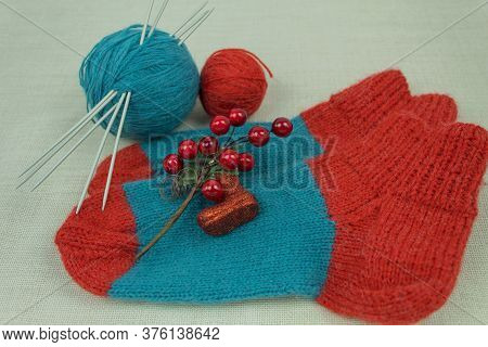 Woolen Knitted Socks And Threads And Knitting Needles