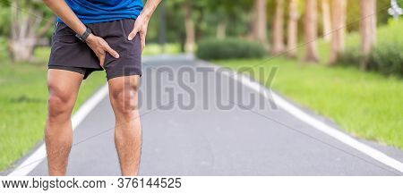 Young Adult Male With Muscle Pain During Running. Runner Have Leg Ache Due To Groin Pull. Sports Inj