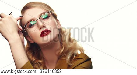 Close-up portrait of a beautiful young woman in modern glasses. Optics and eyewear style.