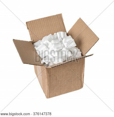 Opened Cardboard Box Filled With Polystyrene Foam Chips Isolated On A White Background