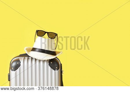 Travel Bag, Luggage, Straw Hat And Sunglasses On Yellow Background With Copy Space. Suitcase, Hat ,