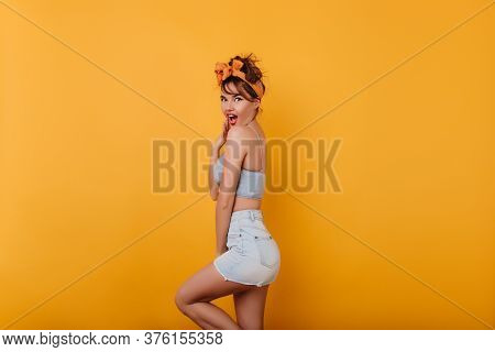 Surprised Shapely Girl Covering Mouth With Hand And Laughing. Lovable European Woman In Light-blue S